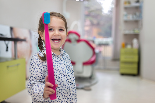 A smiling patient after her first visit at Fircrest Children's Dentistry in Fircrest, WA